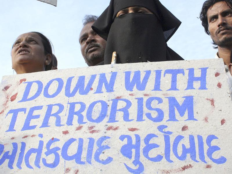 A woman holds a placard during a rally in Ahmedabad against the Mumbai attacks of November 2008. Reuters/Amit Dave