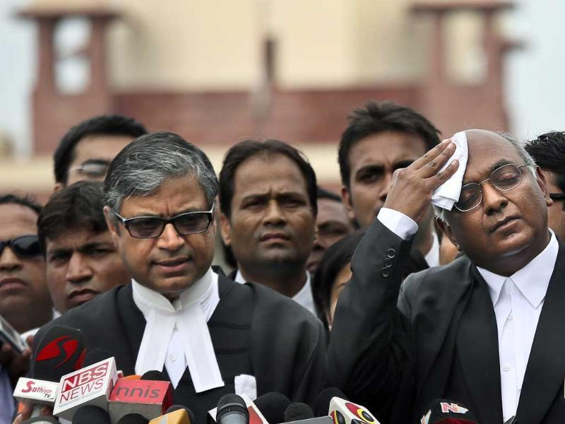 Prosecution lawyer Gopal Subramaniam, left, along with senior advocate Raju Ramachandran, who had been appointed amicus curiae by the Supreme Court to defend Mohammed Ajmal Kasab address the media outside the Supreme Court in New Delhi. AP/Manish Swarup