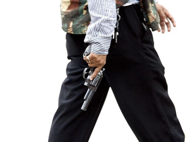 A member of the anti-terror squad carries a gun in front of the Taj Hotel in Mumbai on November 28, 2008. Reuters/Desmond Boylan