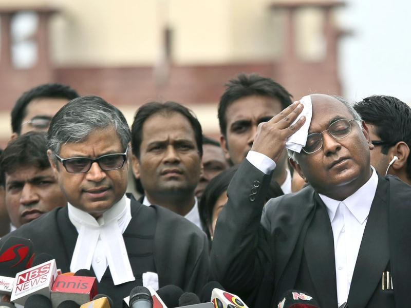 Prosecution lawyer Gopal Subramaniam, left, along with senior advocate Raju Ramachandran, right, who had been appointed amicus curiae by the Supreme Court to defend Mohammed Ajmal Kasab address the media outside the Supreme Court in New Delhi. (AP Photo)