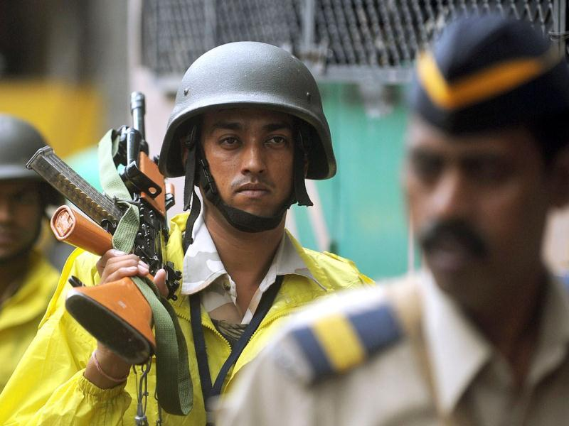 Policemen patrol outside the Arthur Road Prison where the lone surviving gunman Mohammaed Kasab from the 2008 Mumbai attacks is held in Mumbai. AFP
