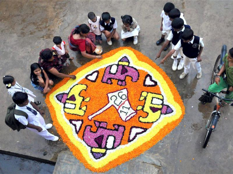 Residents display their happiness in a 'Rangoli' over the Supreme Court's verdict on 26/11 Mumbai terror attack convict Ajmal Kasab, during Onam celebrations at Chikmagalur in Karnataka. PTI