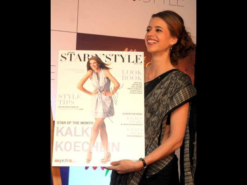 Kalki Koechlin holds up the magazine during the launch. (UNI Photo)