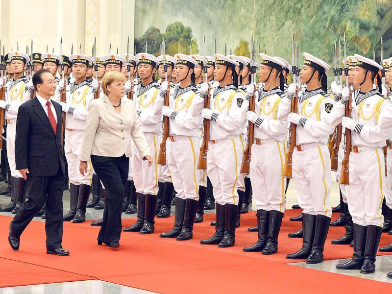 German chancellor Angela Merkel and Chinese Premier Wen Jiabao review an honor guard during her welcoming ceremony at the Great Hall of the People in Beijing. AFP Photo/Mark Ralston