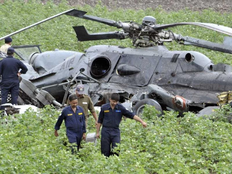 Indian Air Force (IAF) personnel salvage the remains after two air force helicopters collided and crashed at a field in Sarmat village, near Jamnagar in Gujarat. AP photo