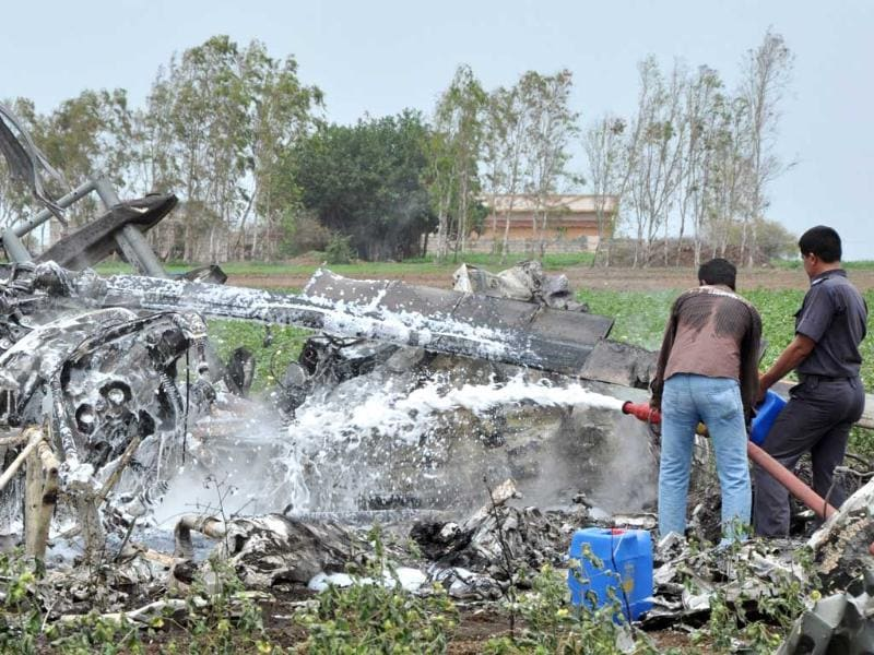 Rescue personnel douse the smouldering wreckage of one of two crashed Indian Air Force Mi-17 helicopters following a mid-air collision near Jamnagar, in Gujarat. AFP photo