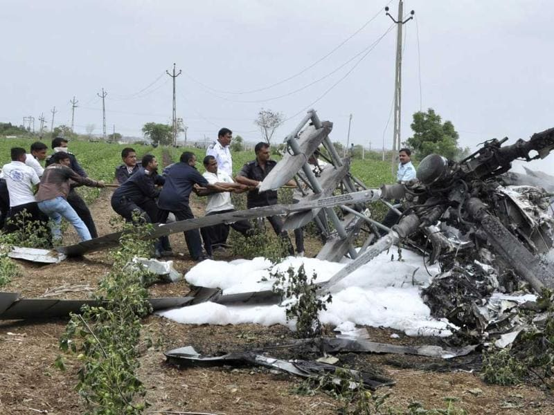 Air Force personnel remove a part of a damaged MI-17 helicopter after a crash near Jamnagar, in Gujarat. Reuters photo