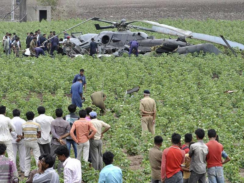 Air Force personnel examine the damaged MI-17 helicopter after a crash near Jamnagar in Gujarat. Reuters photo