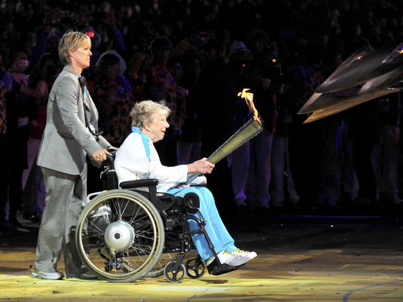Former Paralympic archer, Margaret Maughan, lights the cauldron in the Olympic Stadium during the opening ceremony of the London 2012 Paralympic Games.   Reuters Photo