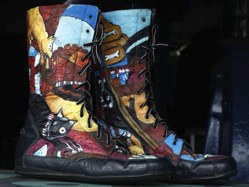 A pair of boots made from recycled material are displayed in Jose Luis Aleman's workshop in San Jose. Reuters/Juan Carlos Ulate