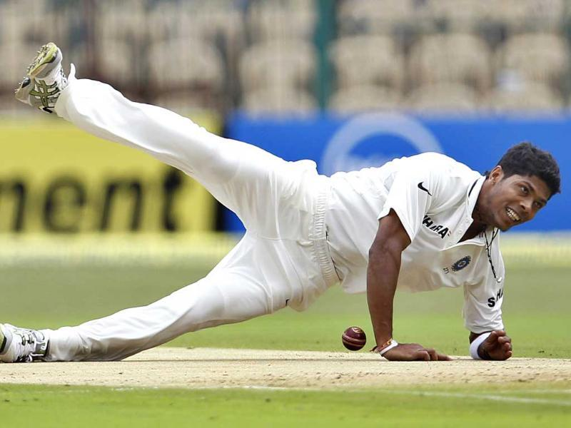 Bowler Umesh Yadav falls on the ground in an attempt to stop the ball after a shot played by New Zealand batsman Kane Williamson. AP/Aijaz Rahi