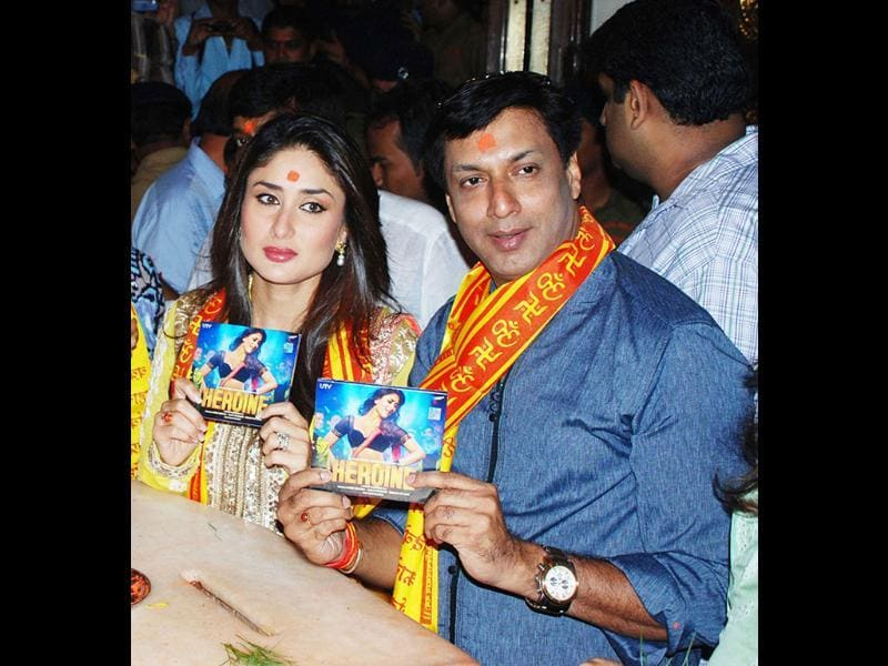 Kareena Kapoor and Madhur Bhandarkar hold up the music DVD of their upcoming film Heroine during their temple visit. (UNI Photo)