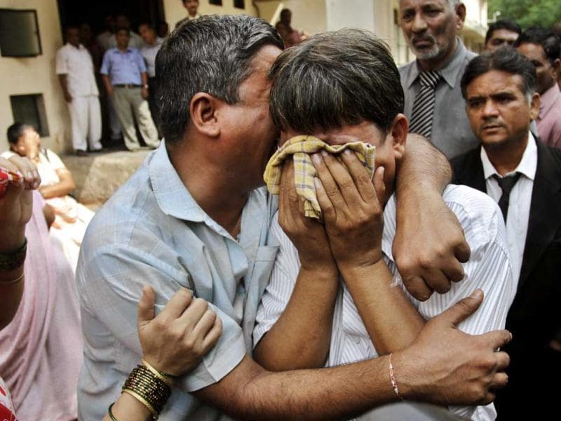 Relatives of the convicts in 2002 Naroda Patiya massacre case, in tears outside the court on the day of pronouncement of sentence in the case, in Ahmedabad. AP Photo/Ajit Solanki