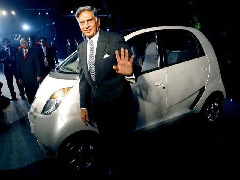 Ratan Tata poses with the company's new Nano car during its launch at the 9th Auto Expo in New Delhi. Reuters Photo