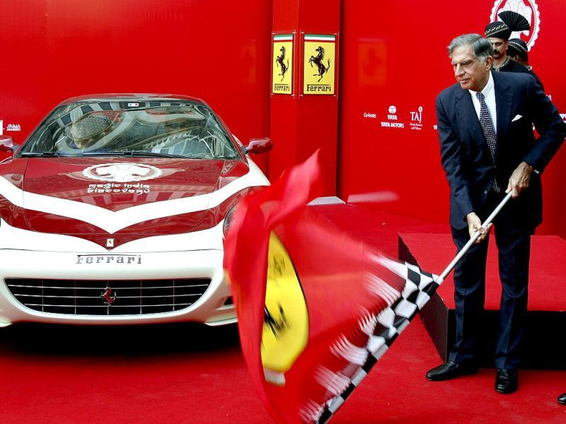 Tata Group chairman Ratan Tata flags off a Ferrari 612 Scaglietti on Magic India Discovery tour in Mumbai. Reuters Photo