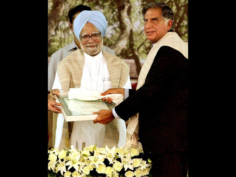 Prime Minister Manmohan Singh presents Ratan Tata with an honorary degree during a function in Mumbai. Reuters Photo