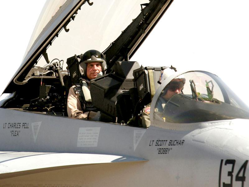 Ratan Tata sits inside the cockpit of a US aircraft during the 'Aero India 2007' air show at Yelahanka air force station, on the outskirts of Bangalore. Reuters Photo