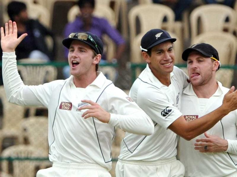 New Zealand's Kane Williamson, Ross Taylor, and Brendon McCullum celebrate the dismissal of Gautam Gambhir on the second day of the 2nd Test match between India and New Zealand at the M Chinnaswamy Stadium in Bangalore. AFP Photo/Manjunath Kiran