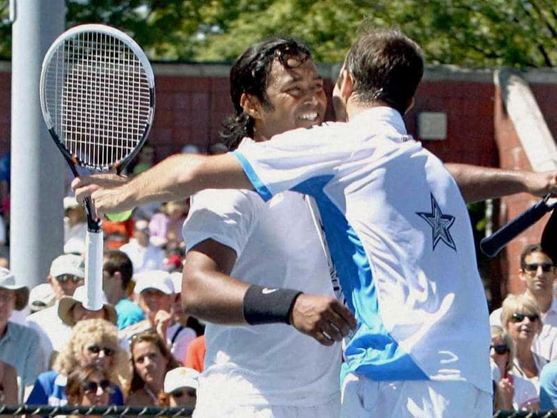 Leander Paes and his partner Radek Stepanek celebrate after winning the 1st round of Men's Doubles Tennis match against Dustin Brown and Christopher Kas at US Open Tennis Tournament. PTI Photo