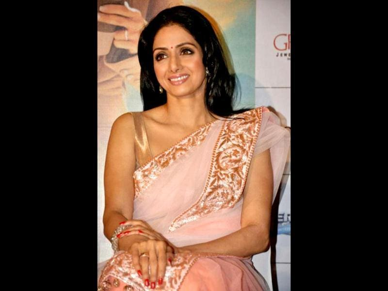 Sridevi is clad in a copper and peachy pink sari by Manish Malhotra.
