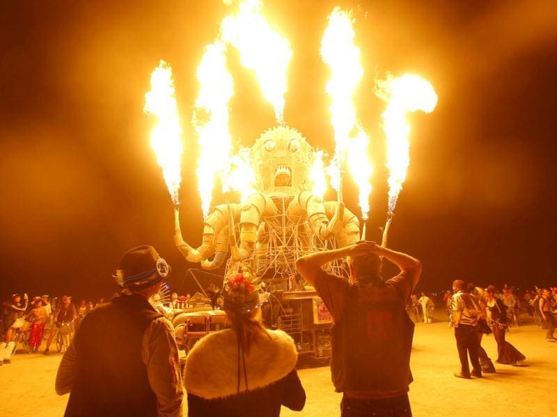 Participants watch the flames from El Pulpo Mecanico during the Burning Man 2012