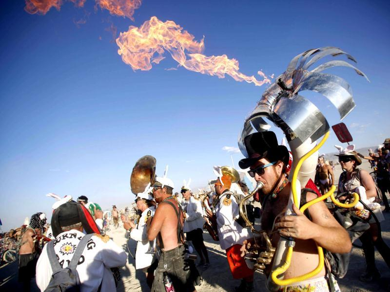 Yttri plays flaming tuba during Burning Man 2012 Fertility 2.0 arts and music festival in Black Rock Desert of Nevada. Reuters