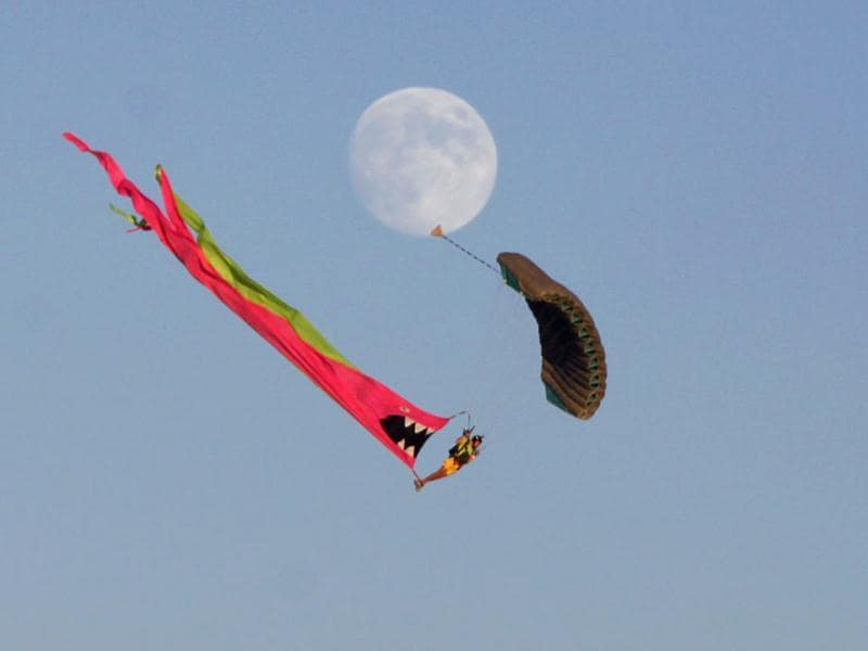 Skydiver descends to the Playa during the Burning Man 2012
