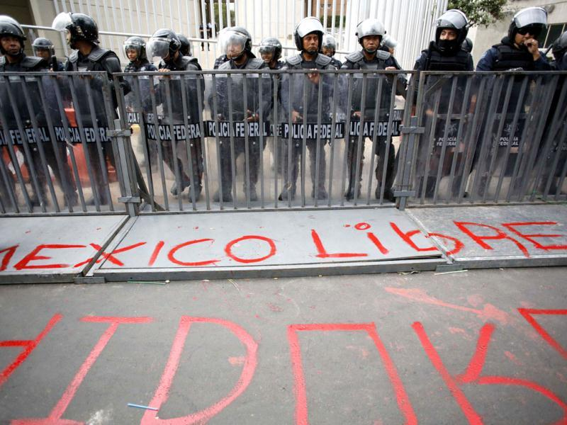 A police line is seen next to a graffiti during a demonstration in support of Andres Manuel Lopez Obrador, runner-up in Mexico's presidential race, after a court threw out his challenge to the poll result, outside Mexico's electoral court in Mexico City. Reuters/Bernardo Montoya