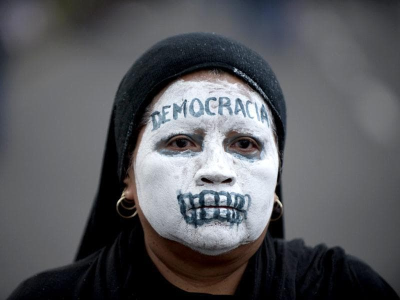 A protester with her face painted participates in a demonstration in front of the Mexican Electoral Tribunal building. Enrique Pena Nieto was declared Mexico's president-elect after a two-month legal fight, but his leftist rival refused to accept the result and called for a rally. AFP/Yuri Cortez