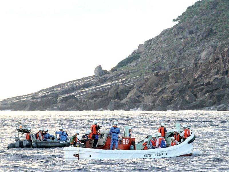 A team of Japanese surveyors conducts an offshore survey from boats near Uotsurijima island, part of the disputed island chain known in Japan as Senkaku and Diaoyu in China. AFP/Japan Pool via JIJI Press