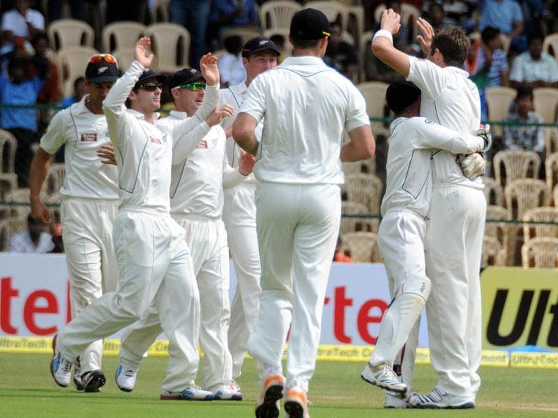 New Zealand players celebrate wicket of Virat Kohli during the 3rd day of second Test match in Bangalore.
