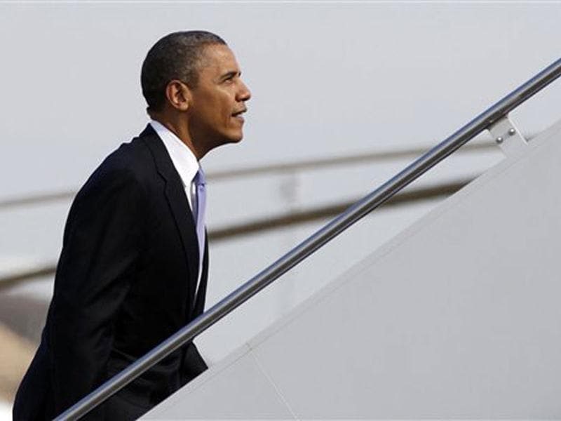 US President Barack Obama board Air Force One at Andrews Air Force Base, Md., en route to Ohio. AP Photo/Carolyn Kaster