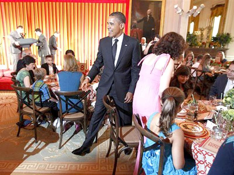 US President Barack Obama greet guests arrive at the first ever Kids'