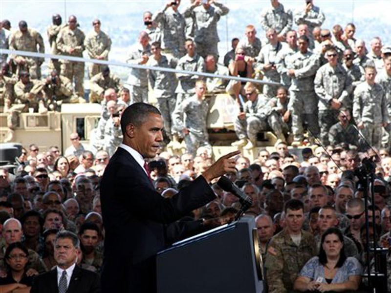 US President Barack Obama speaks to troops, servicemembers and military families at the 1st Aviation Support Battalion Hangar at Fort Bliss in El Paso, Texas. AP Photo/Juan Carlos Llorca