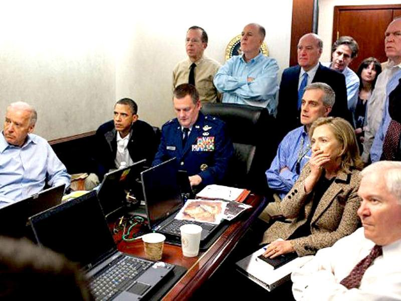 This official White House photo shows US President Barack Obama, US Vice President Joe Biden, US Secretray of Defense Robert Gates, and US Secretary of State Hillary Clinton with members of the national security team as they receive an update on the mission against Osama bin Laden in the Situation Room of the White House, in Washington, DC. AFP Photo