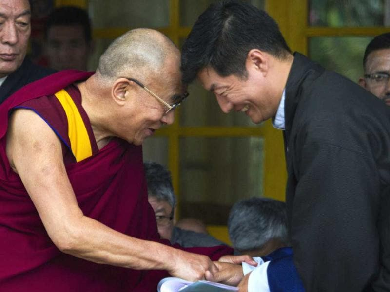 Tibetan spiritual leader Dalai Lama greets Lobsang Sangay, prime minister of the Tibetan government-in-exile during the Tibetan Democracy Day celebrations at the Tsuglakhang temple in Dharamsala. This day in 1960, members of the first Tibetan parliament-in-exile were elected. AP/Ashwini Bhatia