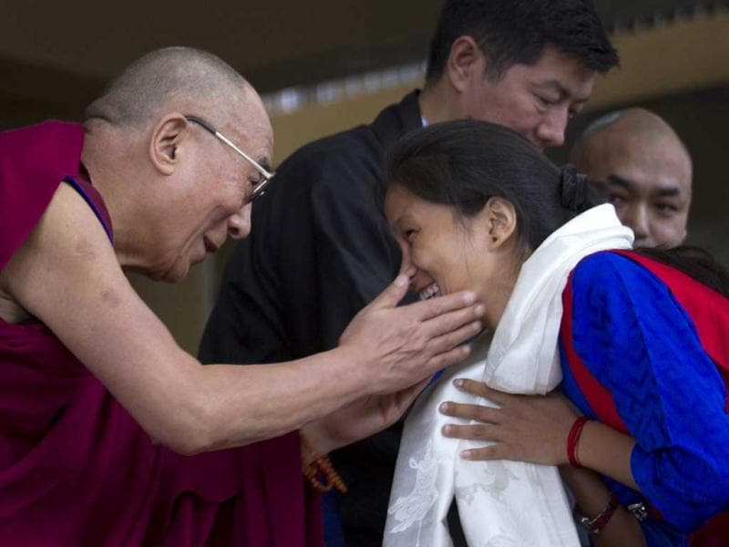 Tibetan spiritual leader Dalai Lama greets a student during the Tibetan Democracy Day celebrations at the Tsuglakhang temple in Dharamsala. On this day in 1960, members of the first Tibetan parliament-in-exile were elected. AP/Ashwini Bhatia