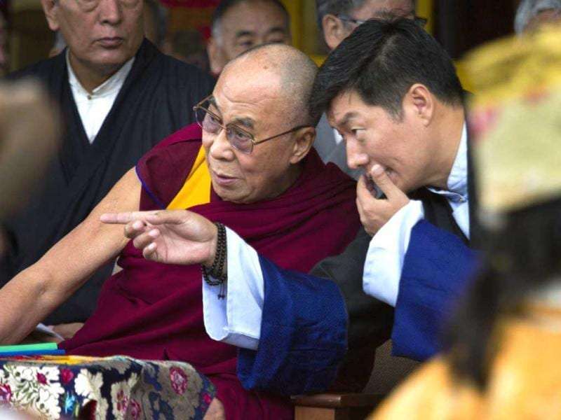 Tibetan spiritual leader Dalai Lama listens to Lobsang Sangay, the prime minister of the Tibetan government-in-exile during the Tibetan Democracy Day celebrations at the Tsuglakhang temple in Dharamsala. On this day in 1960, members of the first Tibetan parliament-in-exile were elected. AP/Ashwini Bhatia