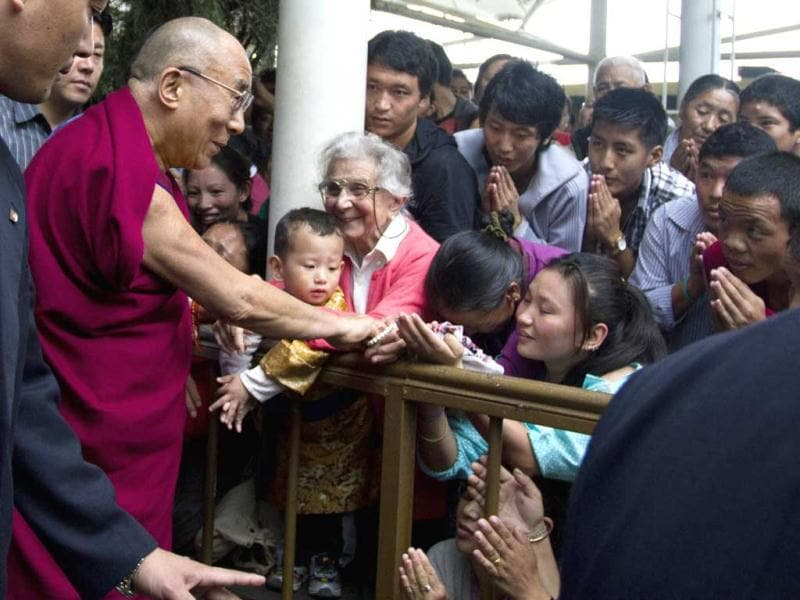 Tibetan spiritual leader Dalai Lama is greeted by devotees as he leaves the Tibetan Democracy Day celebrations at the Tsuglakhang temple in Dharamsala. On this day in 1960, members of the first Tibetan parliament-in-exile were elected. AP/Ashwini Bhatia