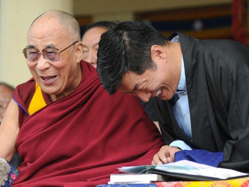 Tibetan spiritual leader Dalai Lama and Prime Minister of the Central Tibetan Administration Lobsang Sangay share a light moment during the 52nd anniversary of Tibetan Democracy Day at the Tsuglakhang temple in McLeod Ganj, Dharamsala. AFP/Lobsang Wangyal