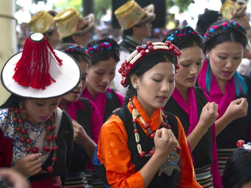 Exile Tibetans perform a traditional dance during the Tibetan Democracy Day celebrations at the Tsuglakhang temple in Dharamsala, India. On this day in 1960, members of the first Tibetan parliament-in-exile were elected. AP/Ashwini Bhatia