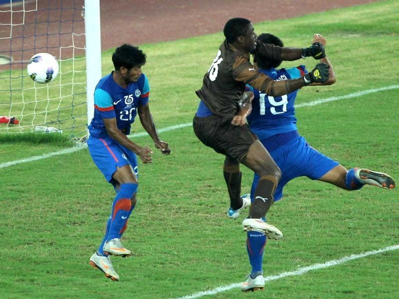 India's Gourmangi Singh (19) scores first goal against Cameroon as Cameroon's goalkeeper Ngome N Lawrence fails to save during Nehru cup final match in New Delhi. (PTI Photo by Vijay Verma)