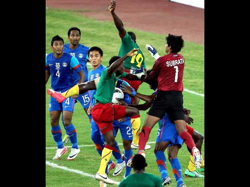 Indian goalkeeper Subrata Paul (1) saves goal against Cameroon during Nehru cup final match in New Delhi. (PTI Photo by Vijay Verma)