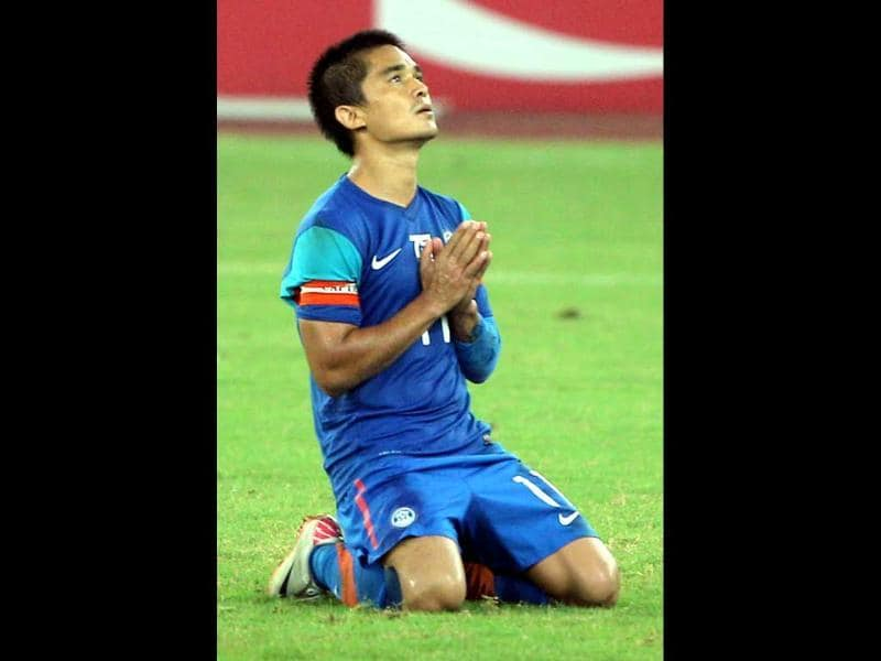 India's captain Sunil Chhetri (11) reacts after scoring team's 2nd goal agianst Cameroon during Nehru cup final match in New Delhi. (PTI Photo by Vijay Verma)