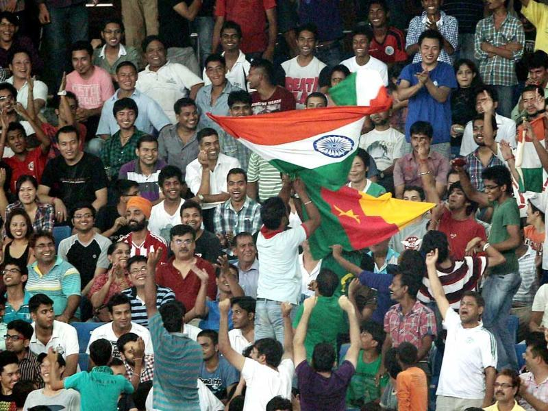 Supporters of India and Cameroon waves theiur national flags during Nehru cup final match in New Delhi. (PTI Photo by Vijay Verma)