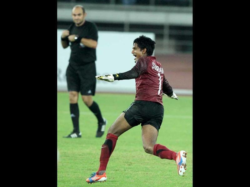 Indian goalkeeper Subrata Paul (1) celebrates after win over Cameroon in tie-breaker by 7-6 during Nehru cup final match in New Delhi. (PTI Photo by Vijay Verma)