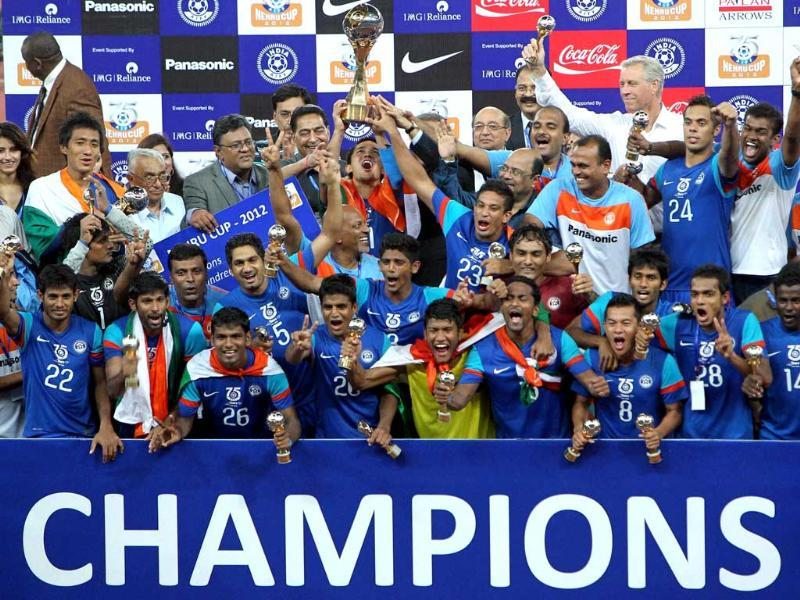 Indian team celebrate with the winning trophy after victory over Cameroon in a tie-breaker by 7-6 during Nehru cup final match in New Delhi. (PTI Photo by Vijay Verma)