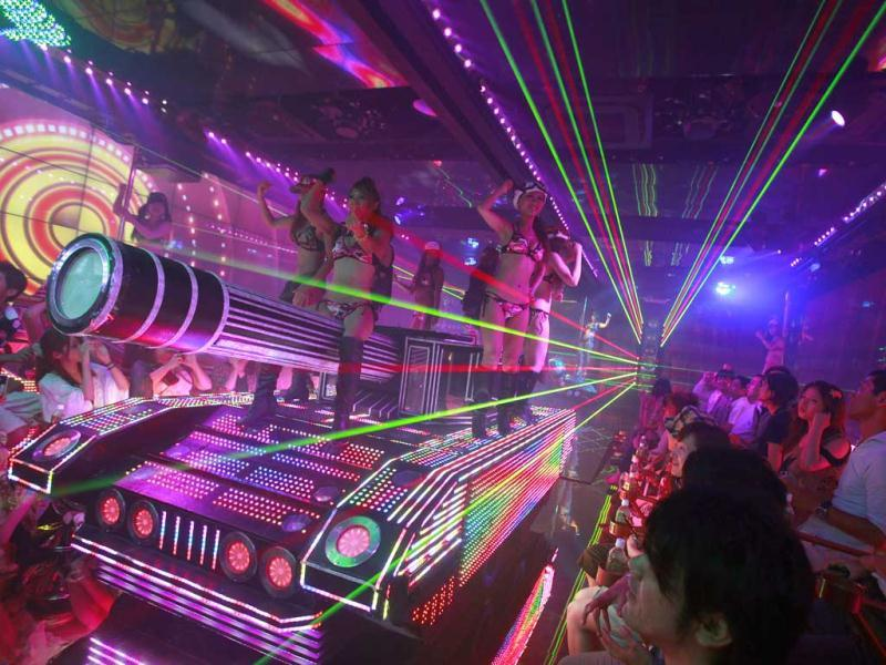 Bikini-clad women are seen on a mock tank decorated with lights, during a show at the newly opened Robot Restaurant in Kabukicho. Reuters Photo