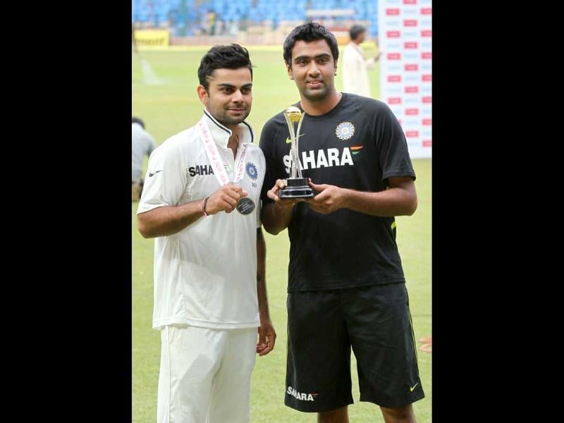 Man of the Match Virat Kohli and Man of the Series R Ashwin pose for lensmen after India won the 2nd test match and series against New Zealand in Bangalore. (PTI Photo by Shailendra Bhojak)