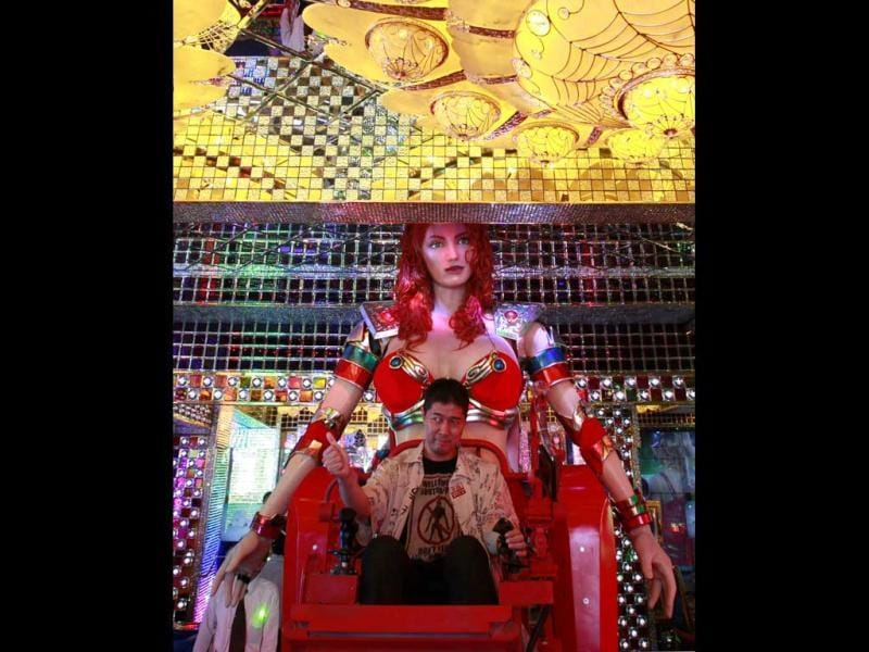 A customer gives a thumbs-up as he is seated on a custom-made female robot at the newly opened Robot Restaurant in Kabukich. Reuters Photo